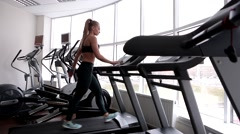 Slim fitness woman go tnan running in Treadmill Stock Footage