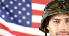 Soldier standing in front of American flag Stock Footage