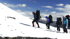 Climbers walk on snow mountain. Stock Footage