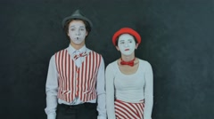 Two young mime crying Stock Footage