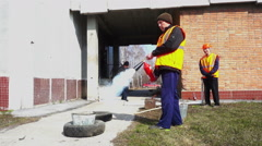 Man using fire extinguisher Stock Footage