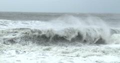 Large Waves Sweep Ashore Onto Rocky Coastline Arkistovideo