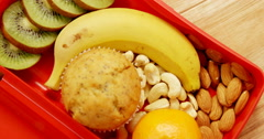 Close-up of dried fruits with banana, kiwifruit and muffin Stock Footage