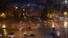 Aerial view of traffic flow and parking lot on raining day at night Stock Footage