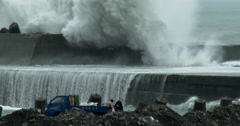 Large Waves Crash Into Sea Wall Near Workers Stock Footage