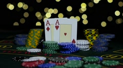 Poker Chips and Two Aces. Close up. Slow motion Stock Footage