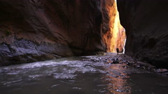 View through a slot canyon in the Zion Narrows in Utah Stock Footage