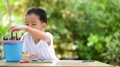 Young Asian boy write on the note book  Stock Footage