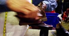 Cobbler polishing a shoe Stock Footage