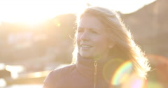Mature female outdoors looking to camera Stock Footage