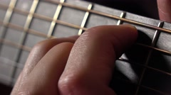 Male hand and strings on fretboard. Music performance. 4K macro video Stock Footage