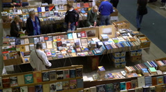 Many lovers of reading, buyers, publishers and books at the book fair. Top view Stock Footage