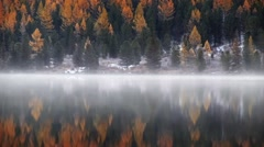 Fog over the water of  Lower Multinskoe lake in the Altai Mountains at late A Stock Footage