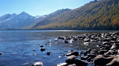 Stones on the bottom of Lower Multinskoe lake in Altai Stock Footage