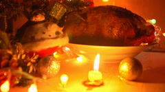 A dish of grilled chicken in the evening on Christmas eve close-up. Stock Footage