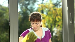 The girl washes a window Stock Footage