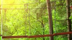 Girl climbing in adventure park Stock Footage
