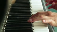 Little girl playing on an old piano Stock Footage