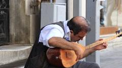 Street musician on the istiklal street in Istanbul, Turkey Stock Footage