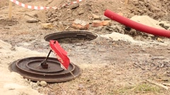 Opened manhole while roadworks Stock Footage