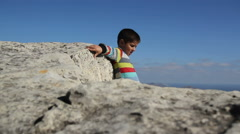 Boy sits amid the valleys and smiling Stock Footage