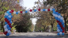 Balloon arch in a park Stock Footage