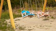 Swing on the playground Stock Footage