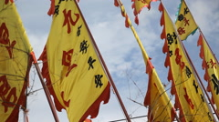 Chinese writing on flag flapping by wind Stock Footage