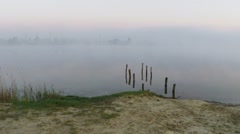 Flying over the misty lake at dawn - aerial survey Stock Footage