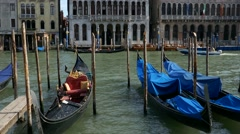 Parking of gondolas in grand canal waiting for tourist costumers, Venice harbor Stock Footage