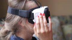 Young woman using VR-helmet at home. Handheld shot Stock Footage