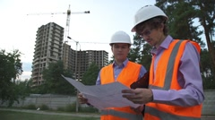 Business, building, teamwork and people concept - group of smiling builders in h Stock Footage