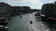 Boats and gondolas transporting people and tourists with boat in grand canal Stock Footage