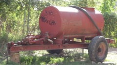 Rusty barrel on wheels Stock Footage