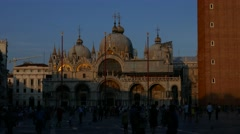 Golden light during sunset on Basilica di San Marco - Crowd of people tourists Stock Footage
