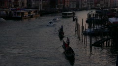 Silhouette Gondolier steering boat standing on gondola, tourists in grand canal Stock Footage