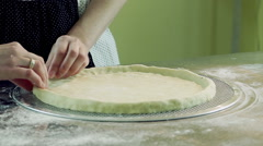 Cooking pizza. Female hands kneading dough and preparing a pizza base. HD Stock Footage