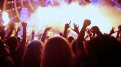 Dancing girl and man fans silhouettes on concert flashing light cheerful hands Stock Footage