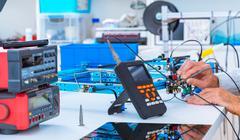Adjusting an industrial robot with a CNC computer control Stock Photos