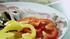 Ingredients for making pizza. Slices of salami, bacon, mushrooms and pepper. HD Stock Footage