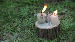 Festive events and sightseeing. candels on wood. Stock Footage