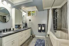 Basement bathroom interior in gray and white tones. Northwest, USA Stock Photos