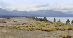 Aerial over a fresh water lake at  Lake Tahoe Stock Footage