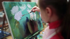 Girl artist painting with oil on easel. Stock Footage