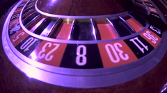Spinning wheel with ball at zero in the roulette game. Close up Stock Footage