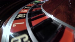 Spinning wheel with ball at number 16 in the roulette game. Number 16 red. Close Stock Footage