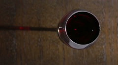 Close up of hand of sommelier holding a glass of red wine. Stock Footage