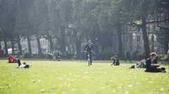 4K Trendy professional man riding bicycle in city park Stock Footage