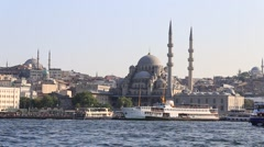 Historic architecture and Muslim Mosque over Golden Horn bay in Istanbul, Turkey Stock Footage