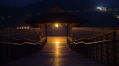 Pathway pier by the ocean mountain at night. Abstract hope and light in darkness Stock Footage